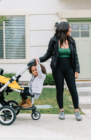 Mom with toddler pushing stroller