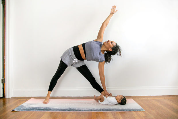 side angle pose mom with baby on yoga mat