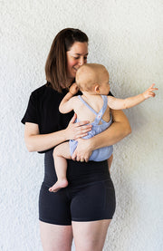 Mom holding baby in athletic clothing