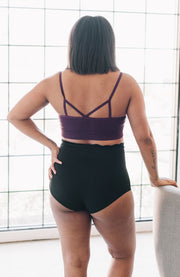 Back of black high-waisted maternity bloomers support wear