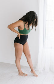 Postpartum woman in high waisted recovery underwear