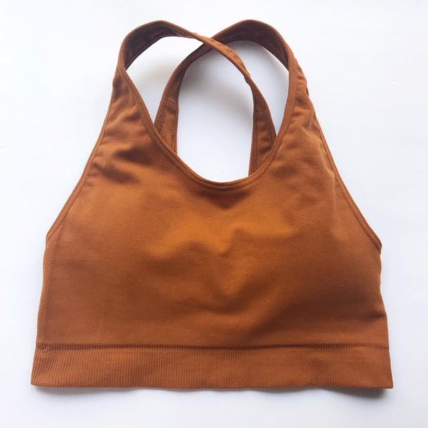 Front of dark tan cross strap sports bra