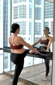 pregnant woman stretching at ballet bar