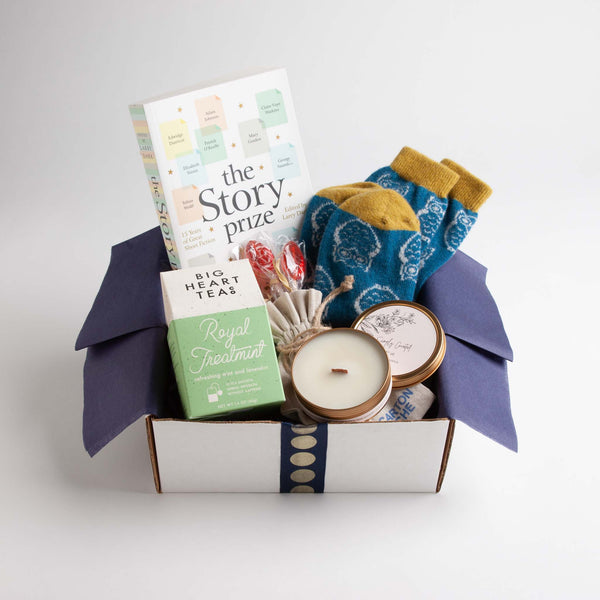 This get well gift includes an award-winning book of short stories, cute and cozy lambswool socks, a lightly fragranced botanical candle, peppermint tea and some spoon-shaped pomegranate honey lollipops to sweeten the pot - teapot, that is.