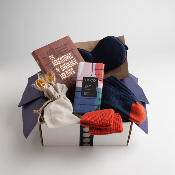 perfect get well gift for men includes The Adventures of Sherlock Holmes, soothing silk eye mask, indigo-striped socks with treads and a delicious dark chocolate bar