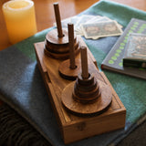 Towers of Hanoi:  Handsome wooden version of the logic game that has been challenging players since 1883.