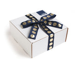 All of our get well gifts come in our trademark white carton and are tied up with a festive navy and metallic gold dotted ribbon.