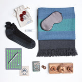 This get well soon care package  includes a lightweight but warm alpaca blanket, cushiony non-slip socks, an addictive wooden game, and playing cards embellished with the most majestic antlers ever seen on an ace of spades.