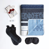 Carton Night Sky - This get well gift for men includes a modern, reversible throw from David Fussenegger in rich shades of grey and navy, an ebony eye mask, alpaca non-slip socks, soothing lip balm and delicious organic lollipops.