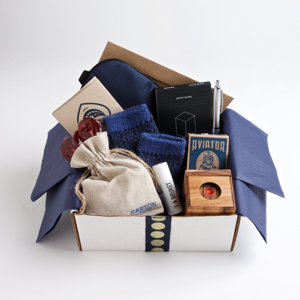 Soft but rugged alpaca socks, a classic deck of cards, moisturizing lip balm and a navy silk eye mask make recuperating as pleasant as possible.