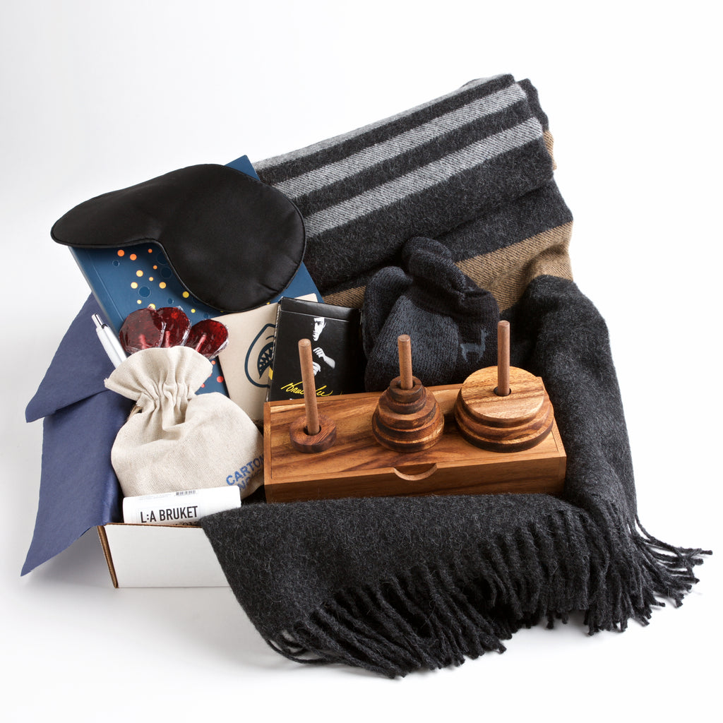 Carton Royale - A silk eye mask, cozy non-slip socks, and a soft alpaca blanket provide the basics for a comfortable recuperation, while a classic wooden game and Bruce Lee playing cards provide some fun. A get well gift almost any man would appreciate.