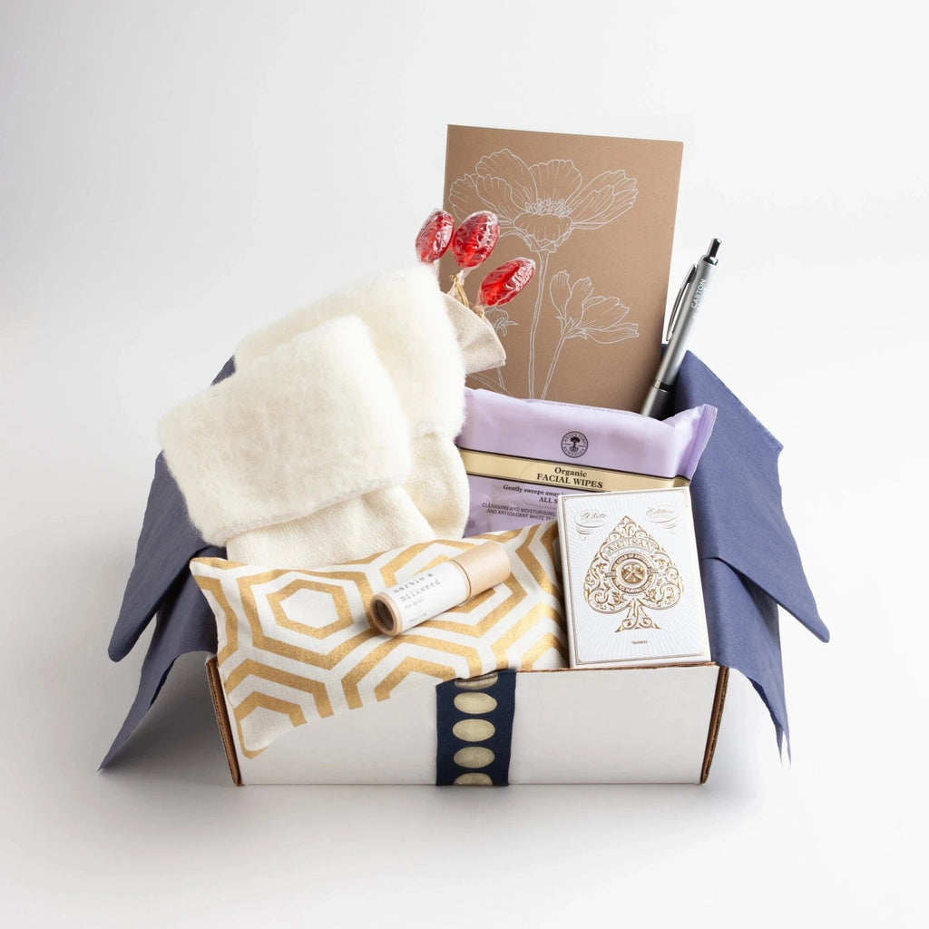Carton Ivory - This carton is brimming with get-well essentials that will lift any patient's comfort level up a notch. A lavender-scented eye pillow, ridiculously cozy socks, rosy lip tint, organic facial wipes, elegant playing cards, and more, round out our best-selling care package.