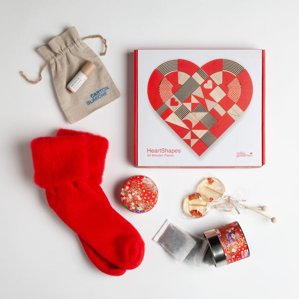 Perfect get well Valentine gift - Miller Goodman Heart Shapes puzzle, rosy lip tint, fuzzy red socks, floral canister filled with strawberry cream tea and a pair of of lovely lollipops.