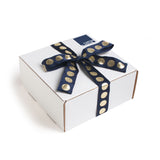 All of our get well care packages come in our trademark white carton tied up with a festive navy and metallic gold dotted ribbon.