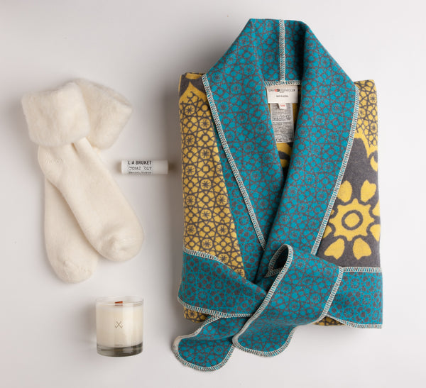 Striking yellow, grey and turquoise plush cotton kimono by David Fussenegger, white fluffy socks, LA Bruket lip balm and a deliciously-scented guava fig candle by Simply Curated make for an extraordinary gift.