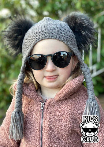 Cute kid with our eyewood sunglasses.