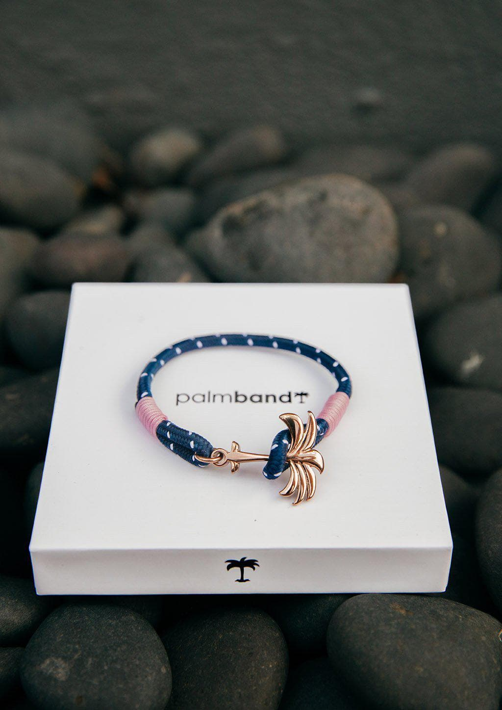 Daybreak - Single - Season two Palm anchor bracelet with pink and blue nylon band. On palm band box.