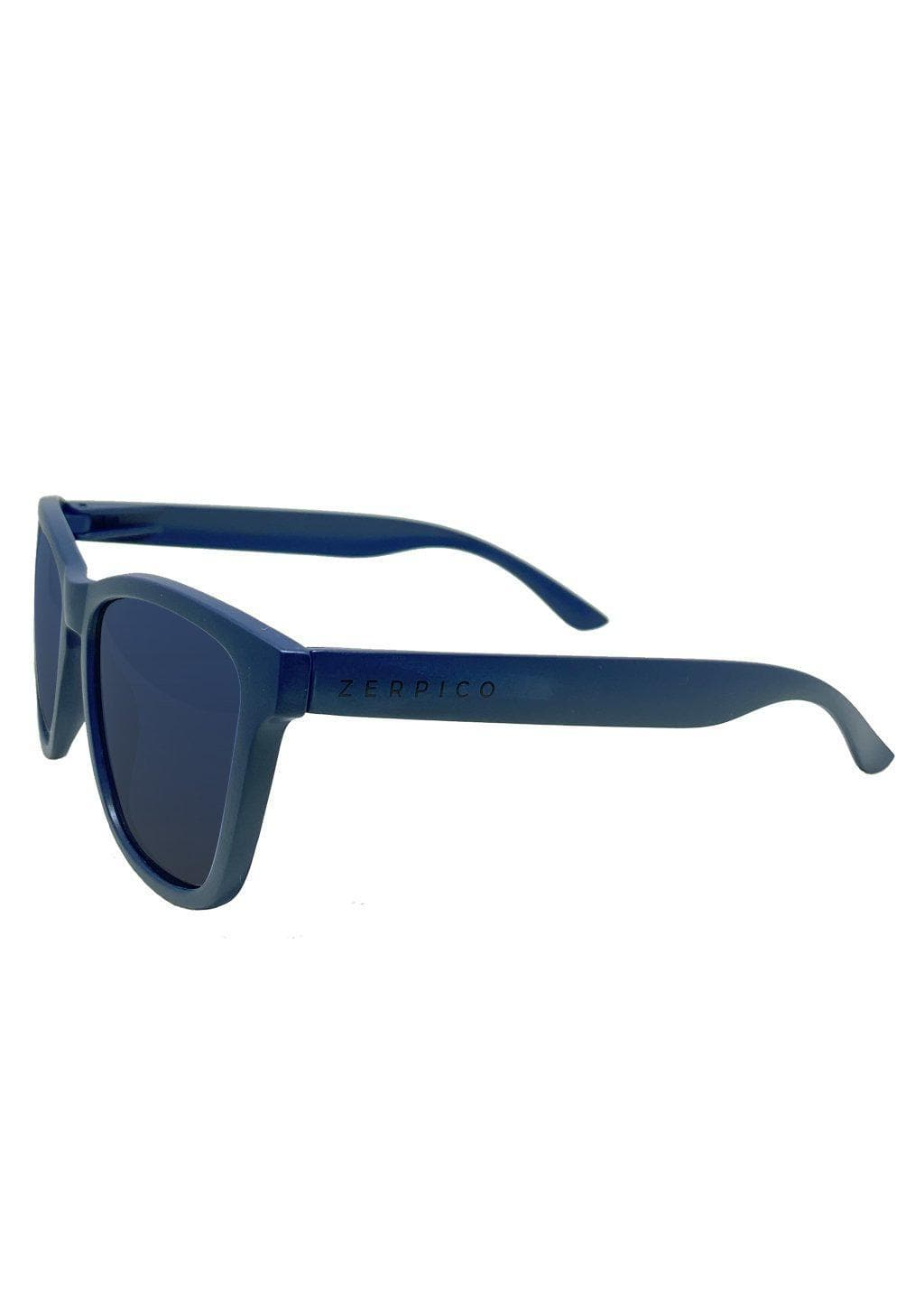 Our Mood V2 is an improved version of our last wayfarers. Plastic body for great quality and durabilty. This is Navy with a matte blue frame and gradient blue lenses. Studio shoot from the side.