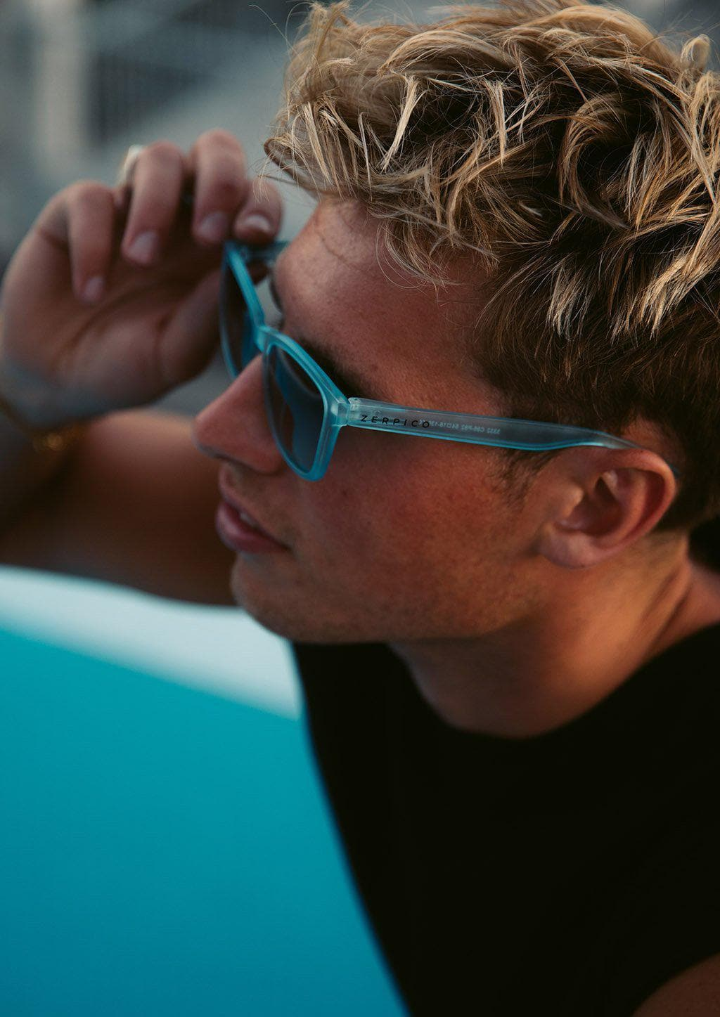 Our Mood V2 is an improved version of our last wayfarers. Plastic body for great quality and durabilty. This is Belize with blue frame and blue lenses. On male model.