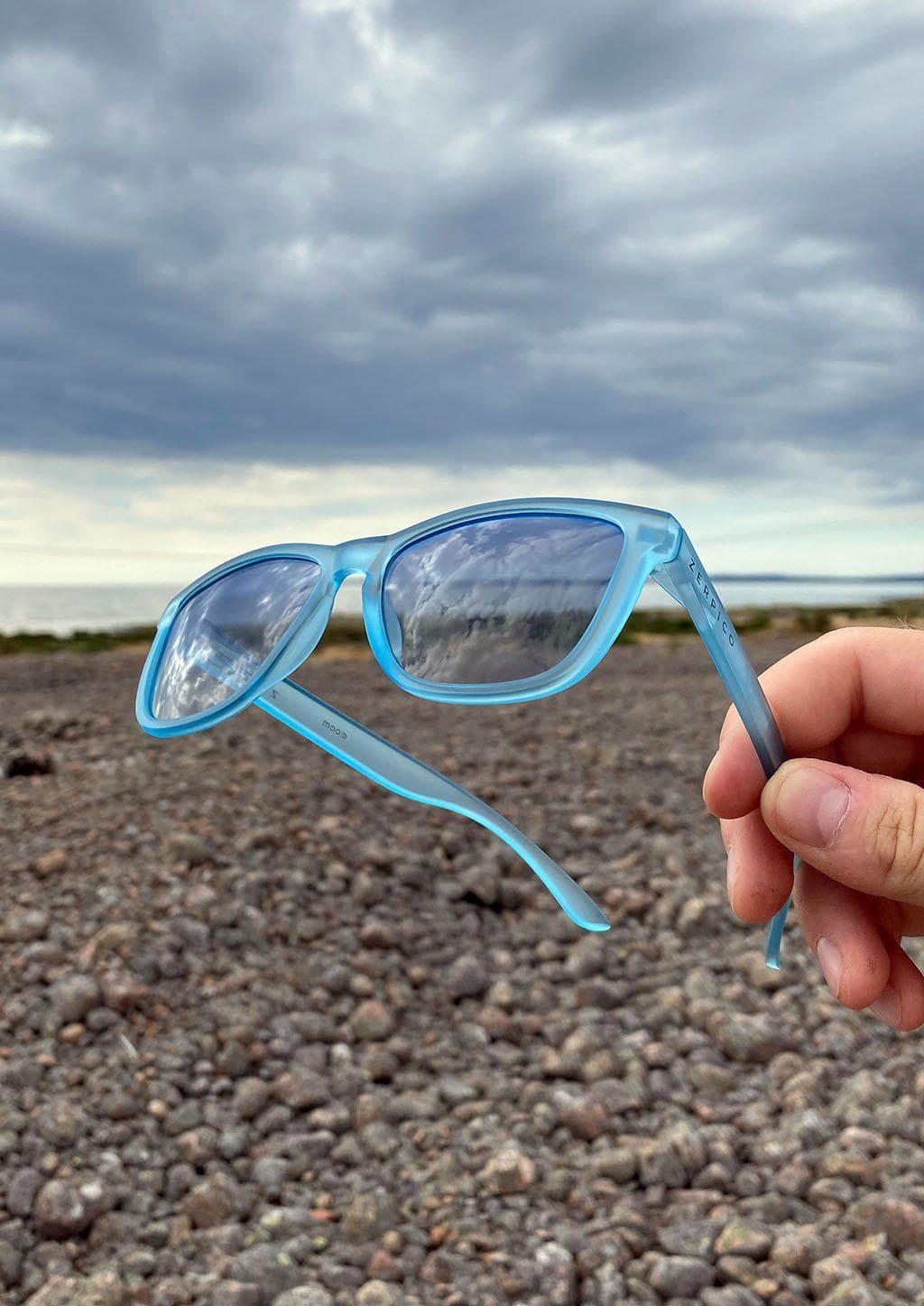 Our Mood V2 is an improved version of our last wayfarers. Plastic body for great quality and durabilty. This is Belize with blue frame and blue lenses. Outside from the side.