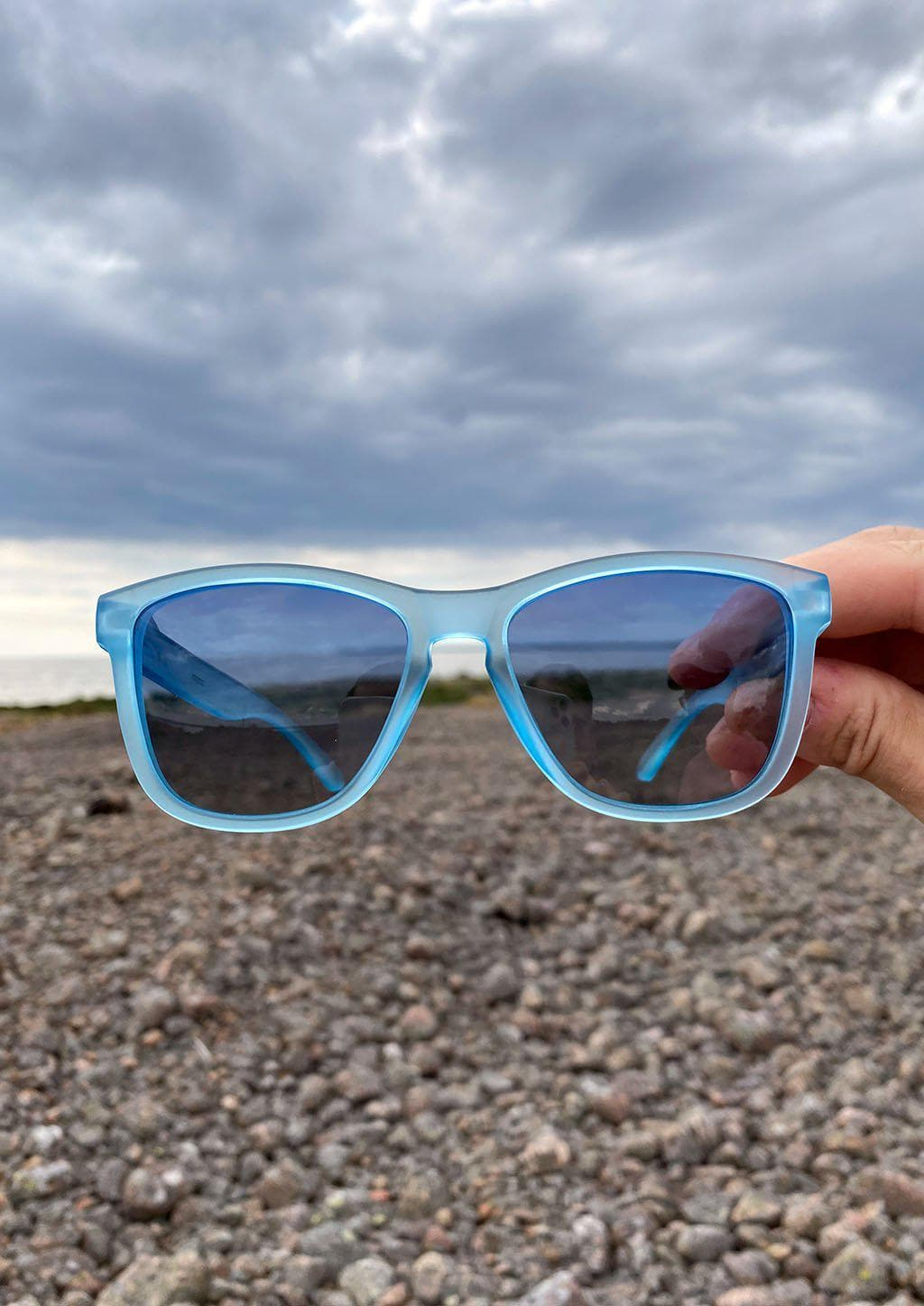 Our Mood V2 is an improved version of our last wayfarers. Plastic body for great quality and durabilty. This is Belize with blue frame and blue lenses. Outside from the front.