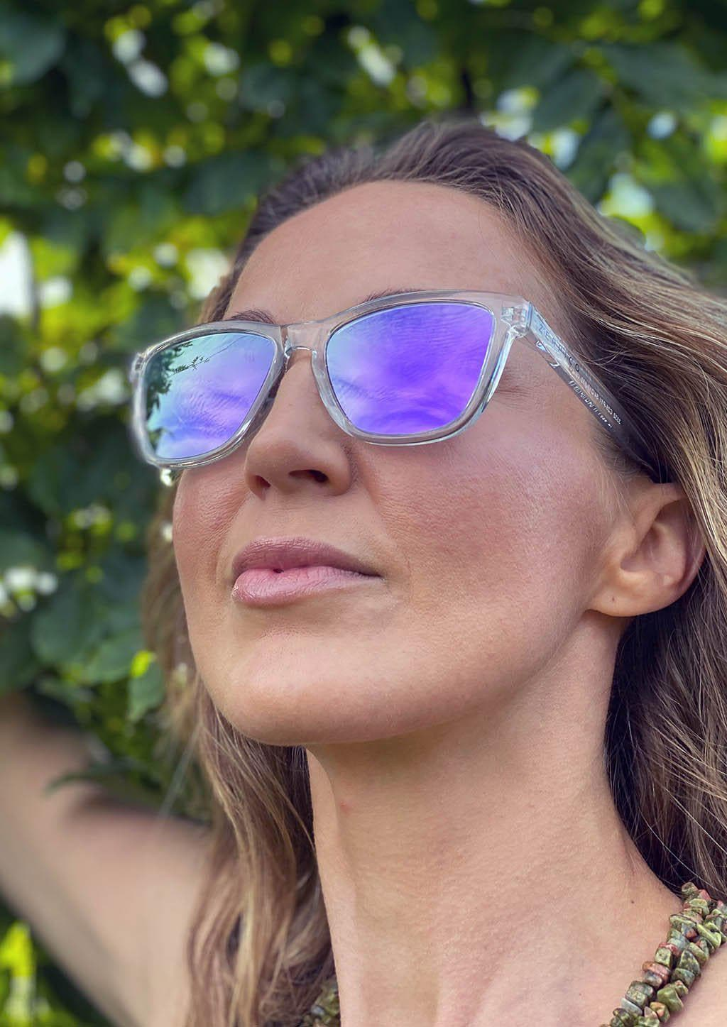 Our Mood V2 is an improved version of our last wayfarers. Plastic body for great quality and durabilty. This is Lucid with transparent frame and purple mirror lenses. From the front on Swedish model.