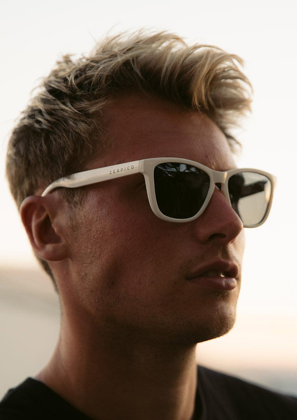 Our Mood V2 is an improved version of our last wayfarers. Plastic body for great quality and durabilty. This is Ace with white frame and black lenses. Lifestyle photo on male model.