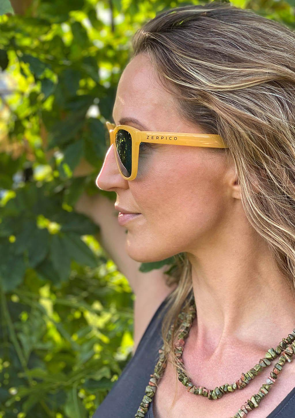 Our Mood V2 is an improved version of our last wayfarers. Plastic body for great quality and durabilty. This is Lemon with yellow frame and green lenses. From the side outside on Swedish model.