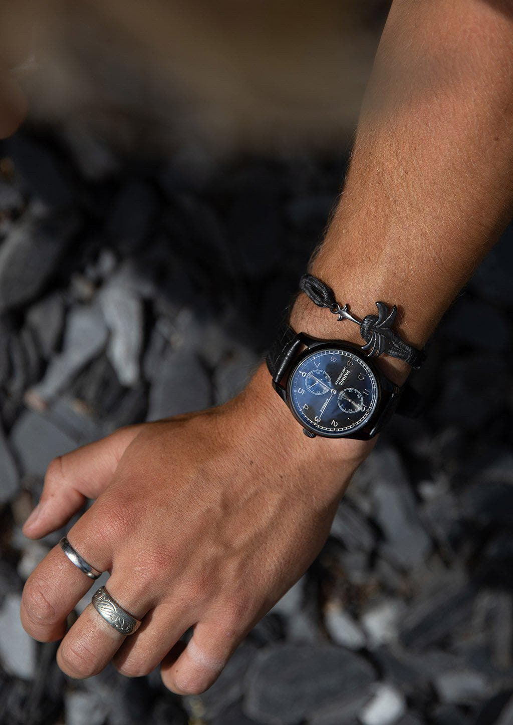 Phantom Black - Single - Season two Palm anchor bracelet with black and grey nylon band. On models hand.