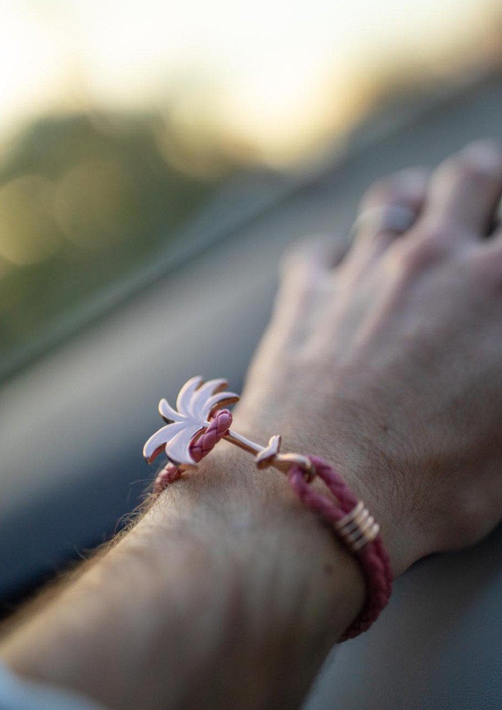 Flamingo Rose - Palm anchor bracelet with pink leather. On male models wrist.