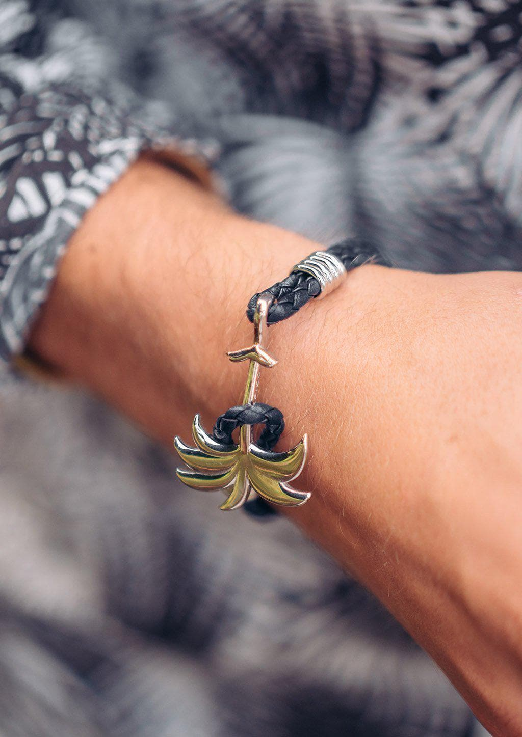 Twilight Silver - Palm anchor bracelet with black leather. On male models arm.