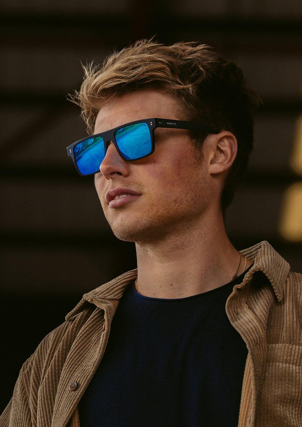 Hybrid - Cubic, carbon fiber and acetate sunglasses of the highest quality. On a model with our blue lenses.