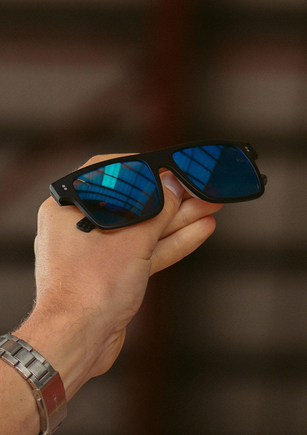 Hybrid - Cubic, carbon fiber and acetate sunglasses of the highest quality. Close up with details.