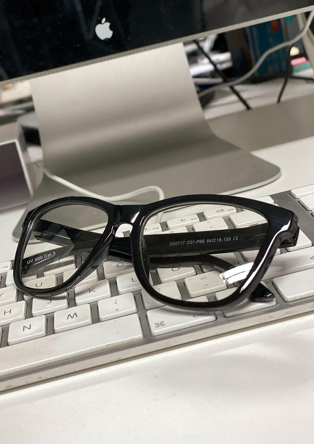 Our Photochromic anti bluelight black glasses that work like two in one. Turns dark in the sun and clear inside.  In Front of the computer.