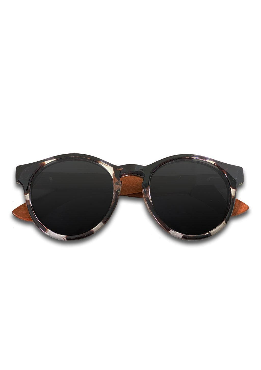 Eyewood Round - Montana - Wooden sunglasses with round black and white frames.