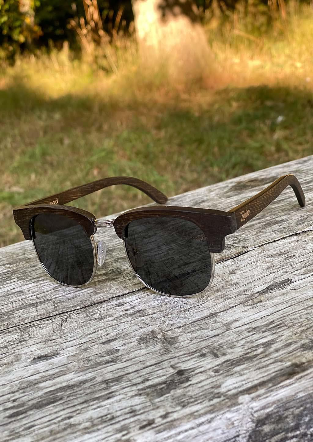 Eyewood Clubmasters is our cool take on classic model. This is Skyler with dark lenses. And also this model is made in all wood. Details in the sun.