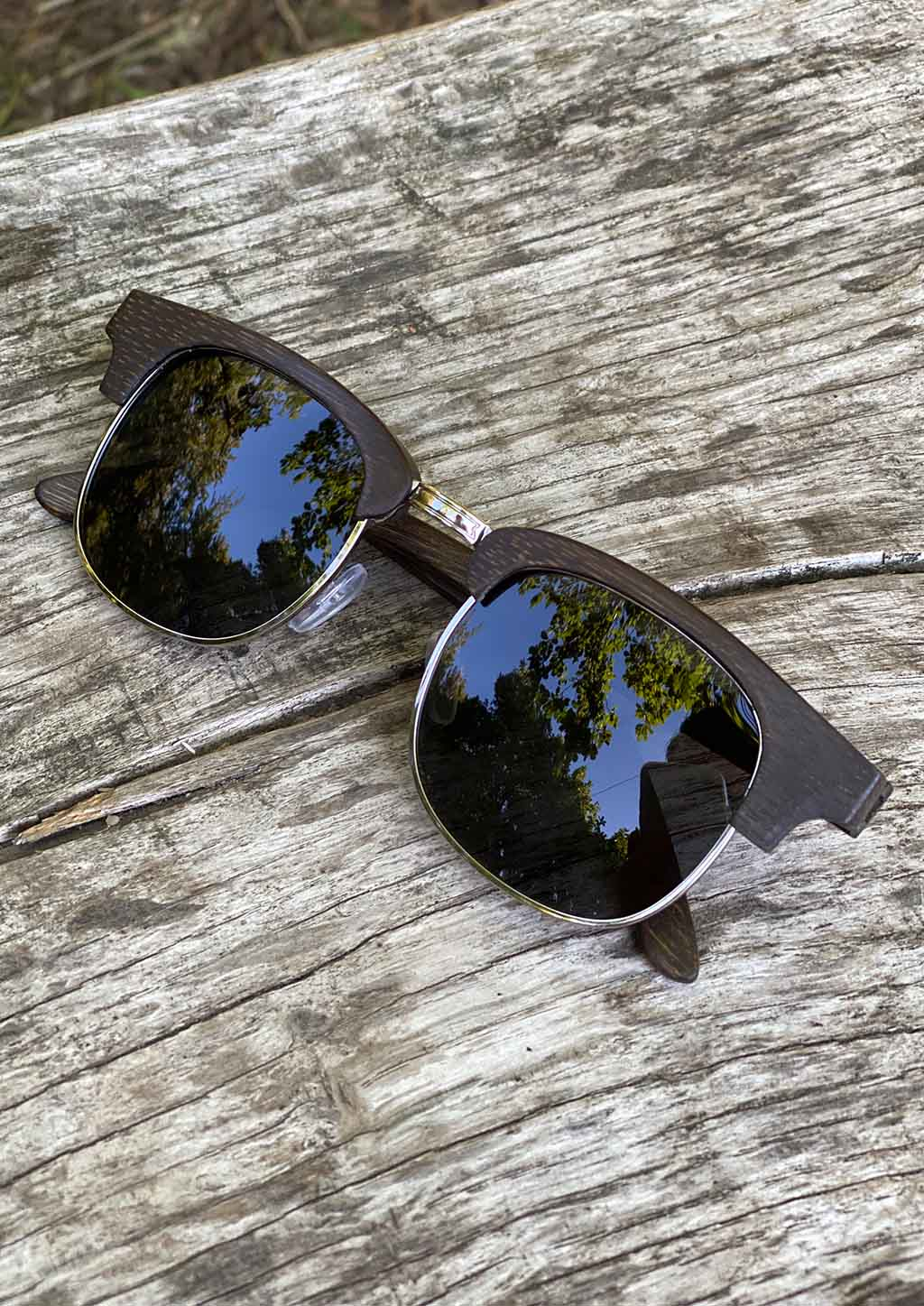 Eyewood Clubmasters is our cool take on classic model. This is Skyler with dark lenses. And also this model is made in all wood. Outside in the sun from the front.