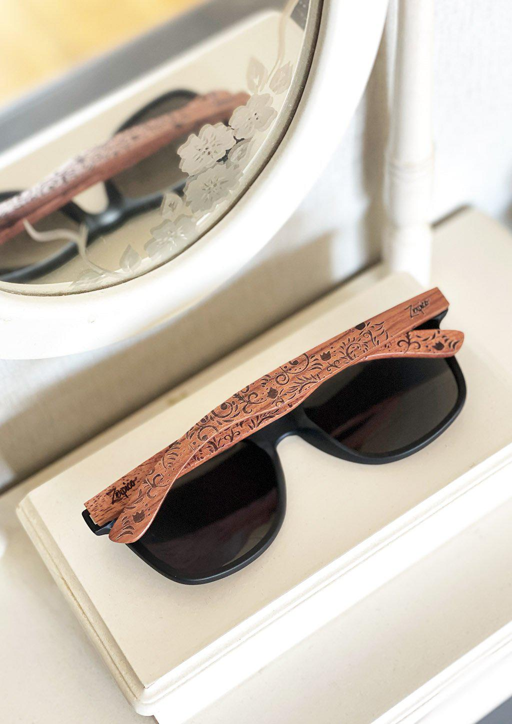 Engraved wood sunglasses from Zerpico. Oasis is handmade with floral pattern.