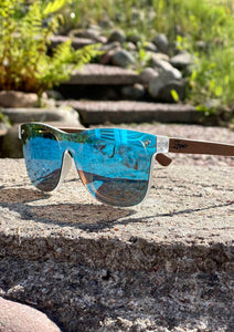 Eyewood tomorrow is our modern cool take on classic models. This is Gemeni with blue mirror lenses. Nice wooden sunglasses. Front in the sun.
