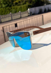 Eyewood tomorrow is our modern cool take on classic models. This is Gemeni with blue mirror lenses. Nice wooden sunglasses. Details from the side outside in the sun.