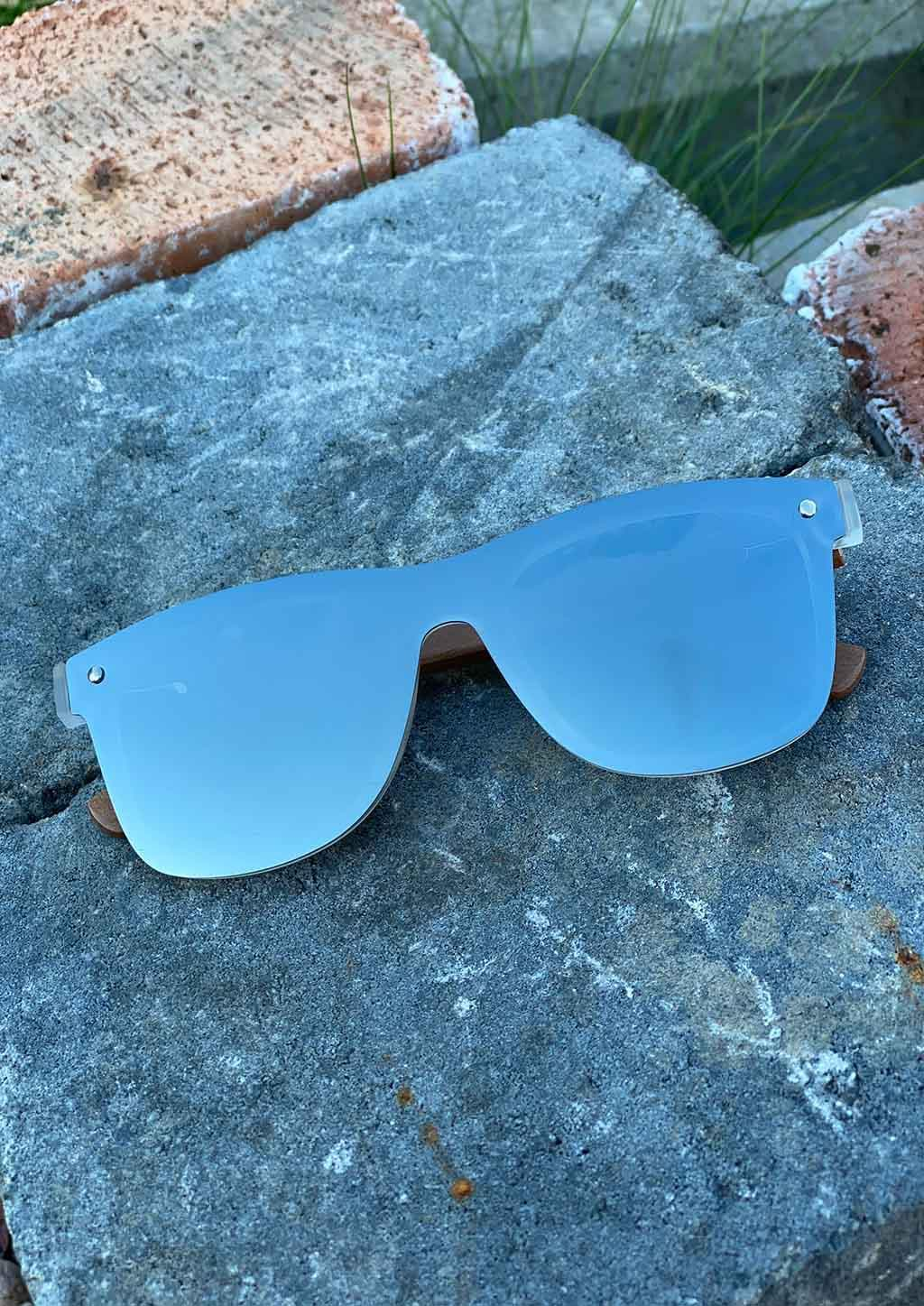 Eyewood tomorrow is our modern cool take on classic models. This is Perseus with silver mirror lenses. Nice wooden sunglasses outside in the sun from the front.