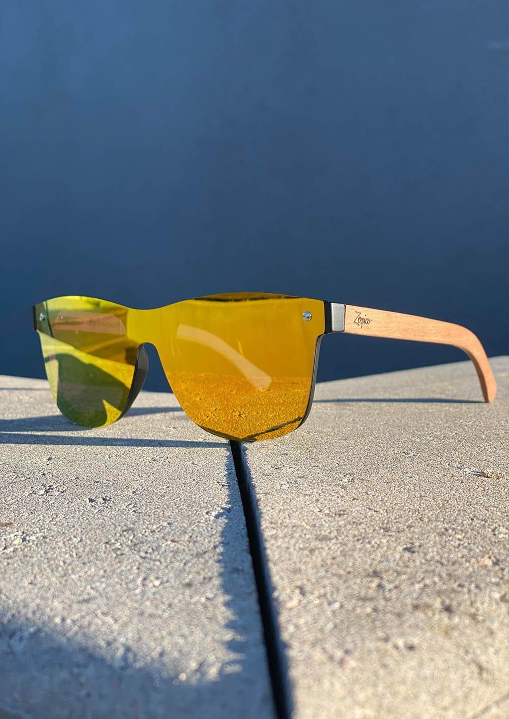 Eyewood tomorrow is our modern cool take on classic models. This is Scorpius with yellow mirror lenses. Nice wooden sunglasses outside in the sun in Sweden.