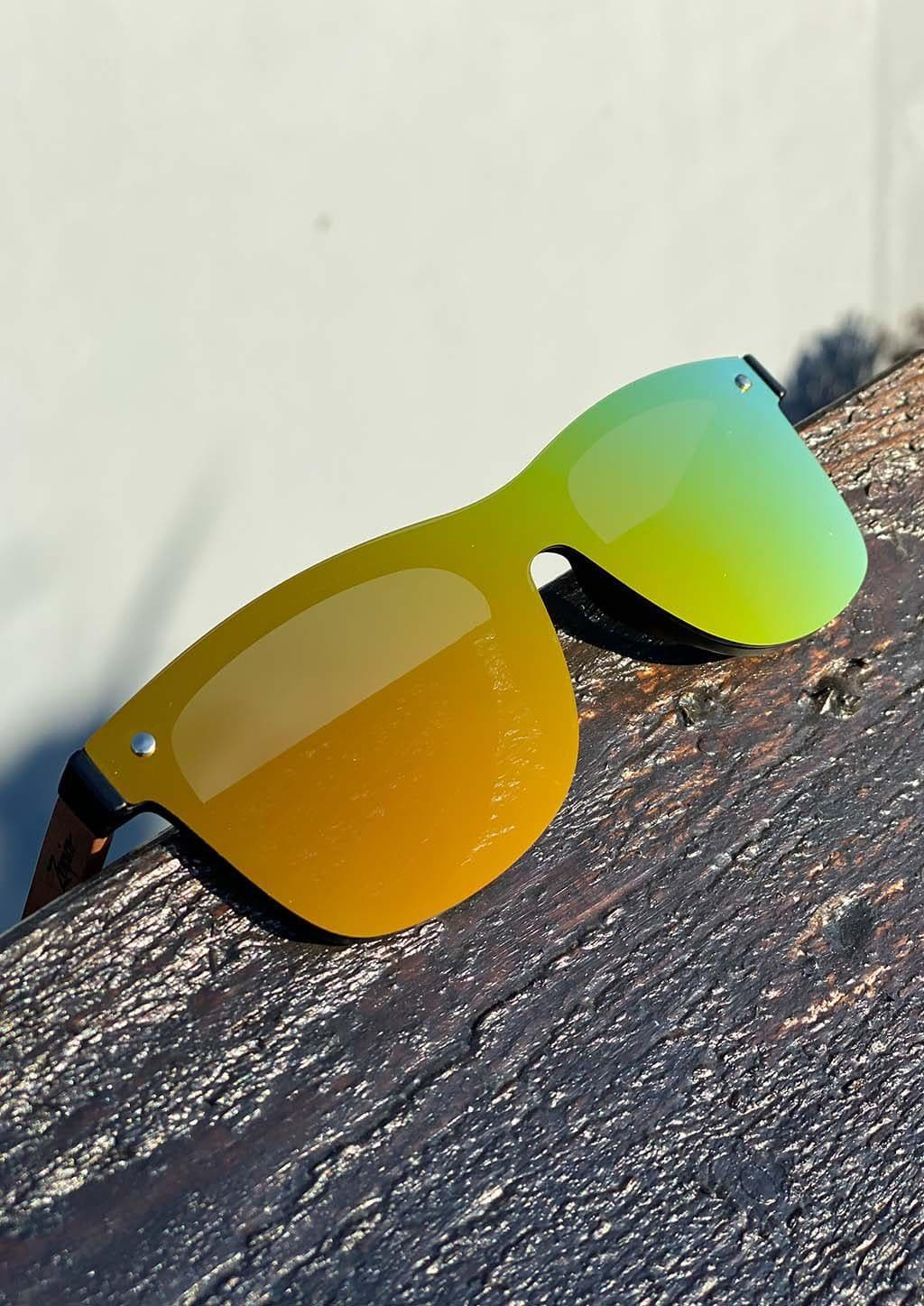 Eyewood tomorrow is our modern cool take on classic models. This is Scorpius with yellow mirror lenses. Nice wooden sunglasses outside in the sun.