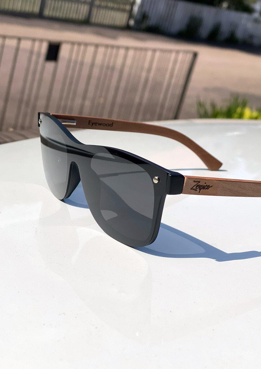 Eyewood tomorrow is our modern cool take on classic models. This is Taurus with black lenses. Nice wooden sunglasses. On White car with details.