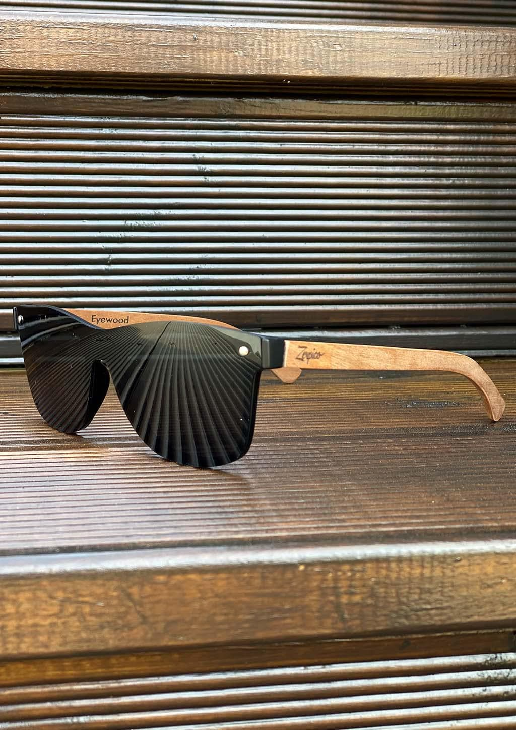 Eyewood tomorrow is our modern cool take on classic models. This is Taurus with black lenses. Nice wooden sunglasses. Outside with details.
