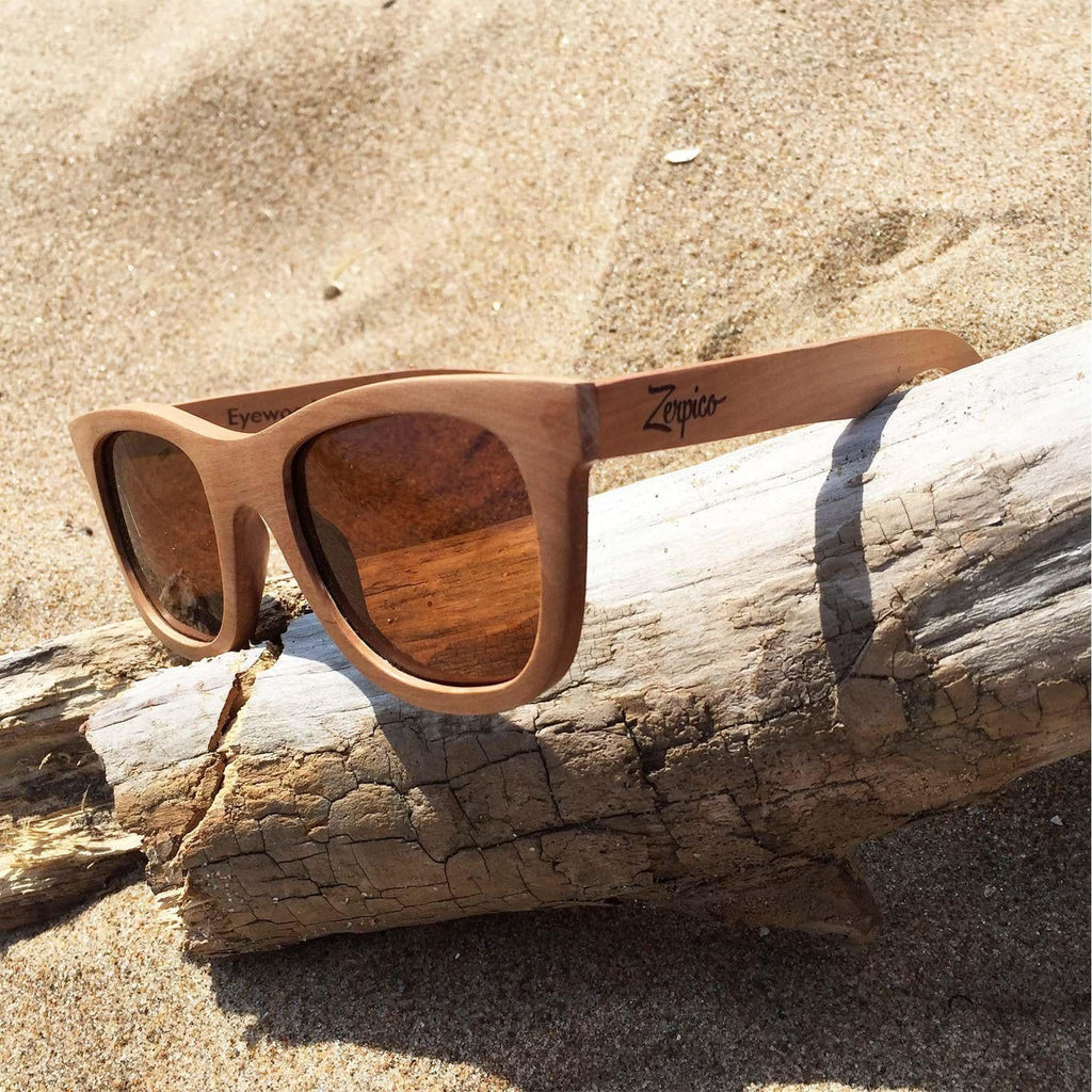 Eyewood Wayfarer - Waki - All wooden sunglasses on a tree in the sand