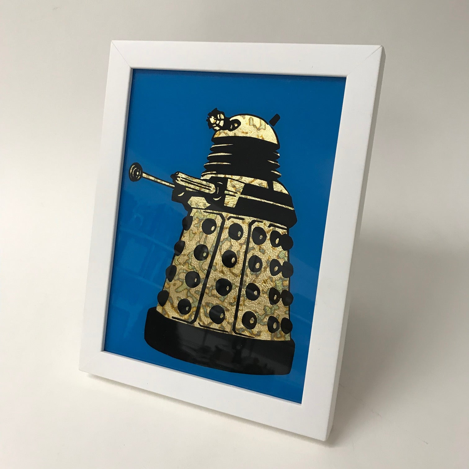 Framed Gilded and Burnished Gold Dalek