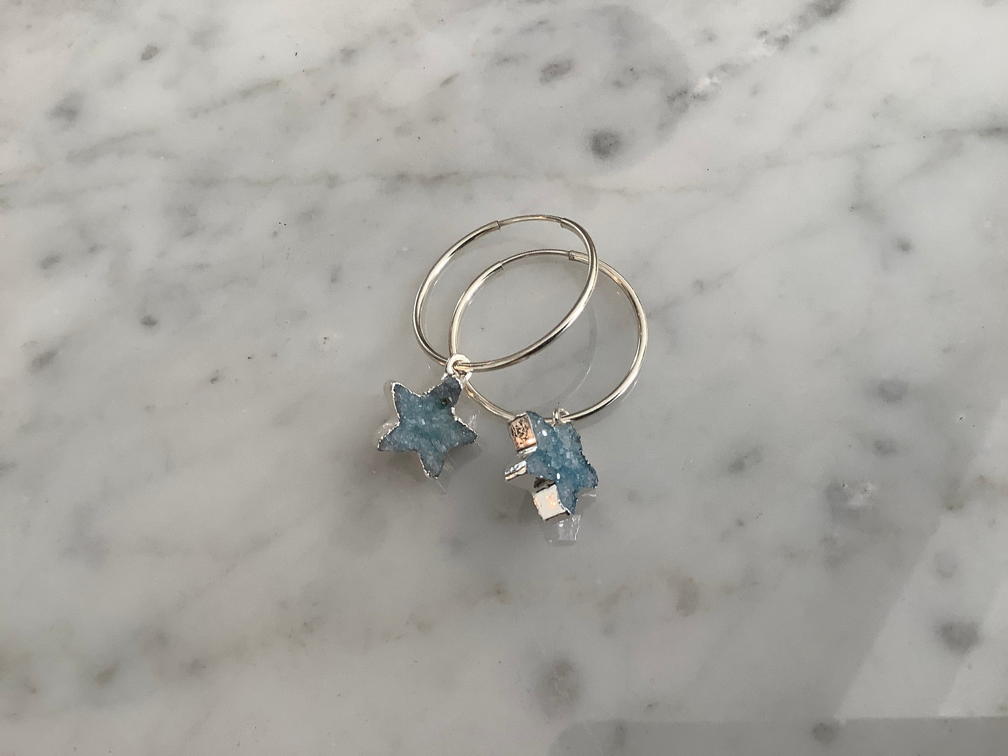 Sterling silver hoop earrings with pale blue drusy quartz stars