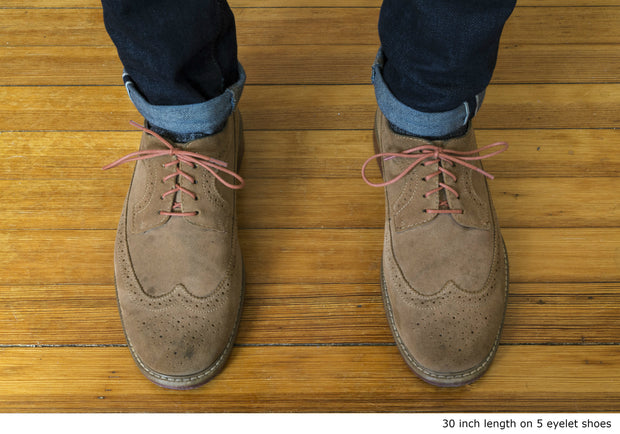 burnt-orange-round-waxed-cotton-shoelaces-on-shoes