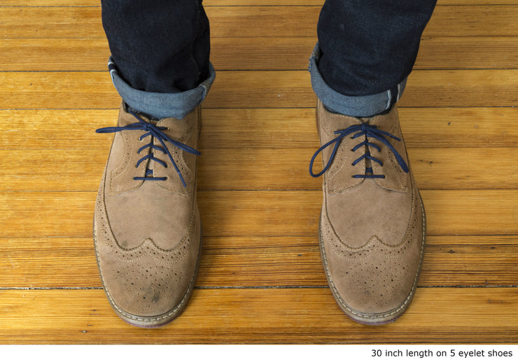 navy-blue-round-waxed-cotton-shoelaces-on-shoes